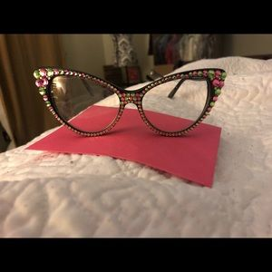 Pink and green fashion glasses.